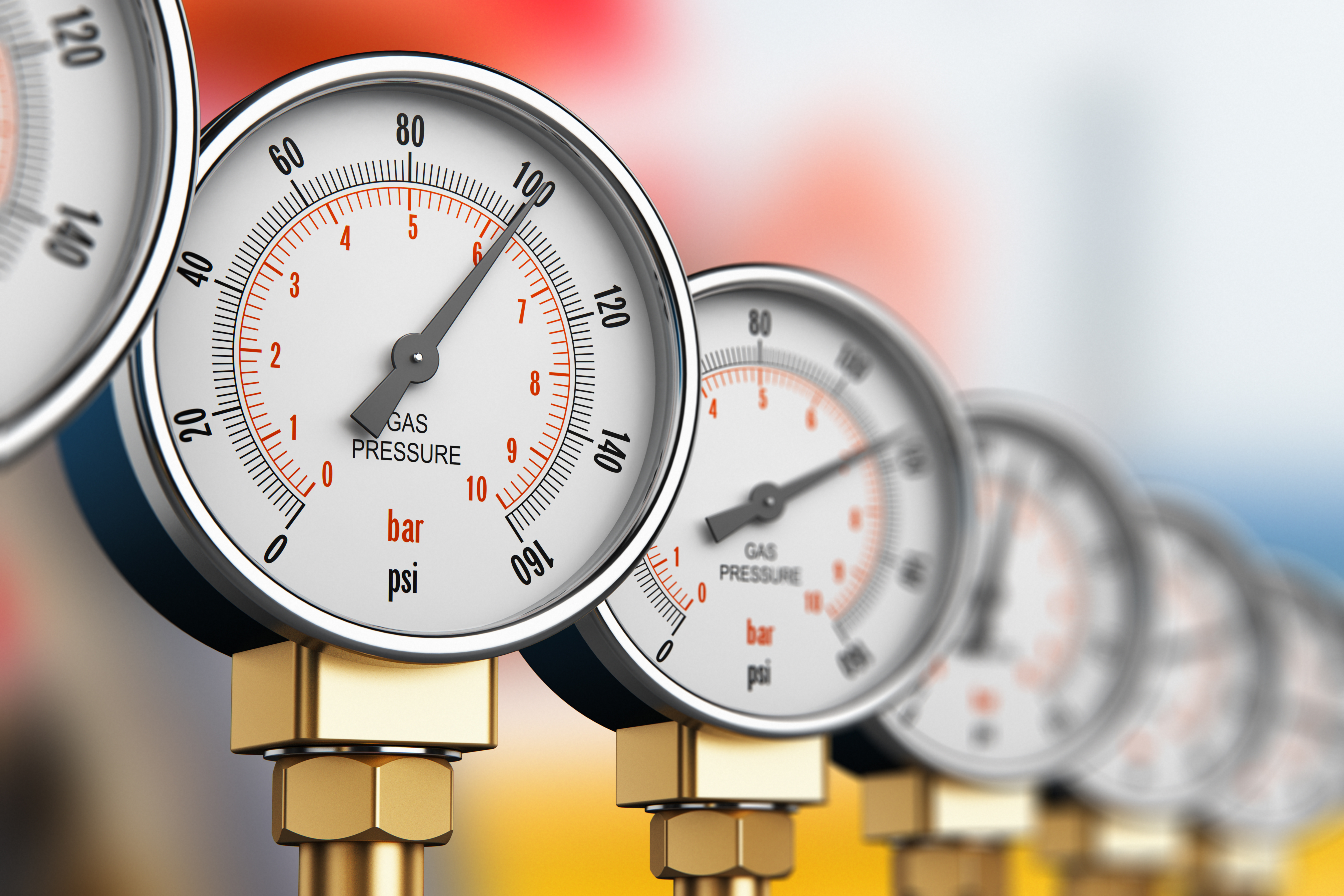 Row of industrial high pressure gas gauge meters